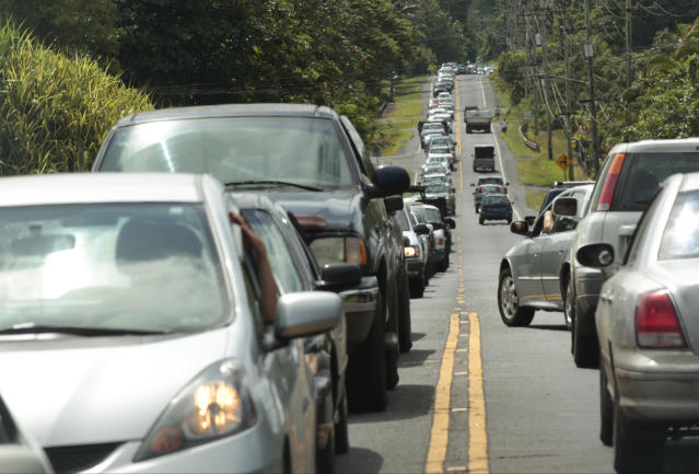 <p>In this Sunday, May 6, 2018, photo, traffic is seen along Highway 132 as Leilani Estates residents wait to return to their homes to gather vital belongings and animals in Pahoa, Hawaii. (Photo: Jamm Aquino/Honolulu Star-Advertiser via AP) </p>