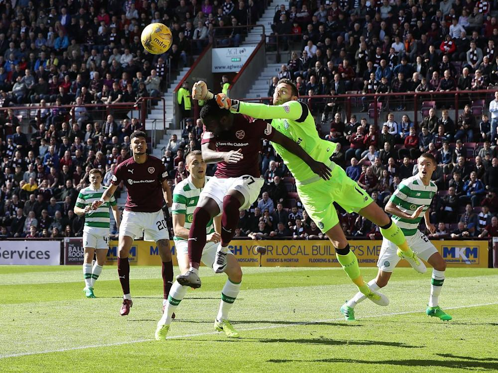 Esmael Goncalves of Hearts vies with Celtic goalkeeper Craig Gordon (Getty)