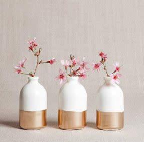 """This Georgia-based Amazon Handmade shop specializes in handcrafted porcelain home decor. Find these <a href=""""https://amzn.to/31unVPG"""" rel=""""nofollow noopener"""" target=""""_blank"""" data-ylk=""""slk:white and gold porcelain bud vases"""" class=""""link rapid-noclick-resp"""">white and gold porcelain bud vases</a> for $40."""