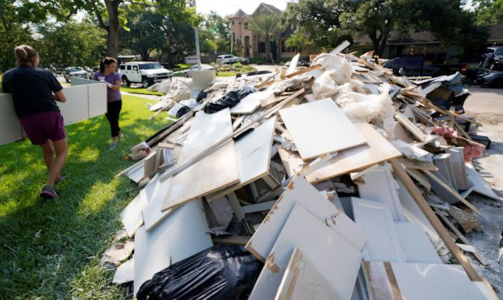 Church volunteers work help clear out a damaged home.