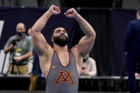 FILE - Minnesota's Gable Steveson celebrates after defeating Michigan's Mason Parris in their 285-pound match in the finals of the NCAA wrestling championships in St. Louis, in this Saturday, March 20, 2021, file photo. The NCAA heavyweight champion is brimming with confidence heading into the biggest competition of his career. His stardom was seemingly planned from the beginning — his mother named him Gable Dan -- after amateur wrestling icon Dan Gable. (AP Photo/Jeff Roberson, File)