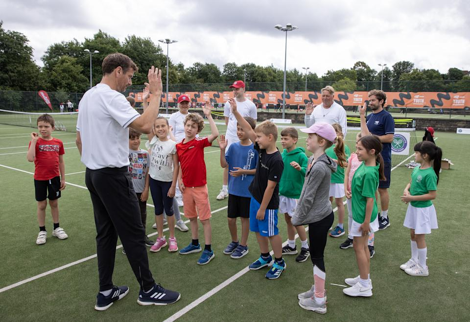 The 'Thank you Day' event helped inspire children and adults of all ages and abilities to pick up a racket