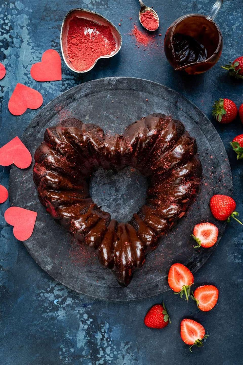 "<p>Made with love, this sweet cake will blow away your SO. It's easy to make and pairs well with strawberries, so get bakin'!</p> <p><strong>Get the recipe</strong>: <a href=""https://www.supergoldenbakes.com/chocolate-bundt-cake/"" class=""link rapid-noclick-resp"" rel=""nofollow noopener"" target=""_blank"" data-ylk=""slk:vegan chocolate heart-shaped bundt cake"">vegan chocolate heart-shaped bundt cake</a></p>"