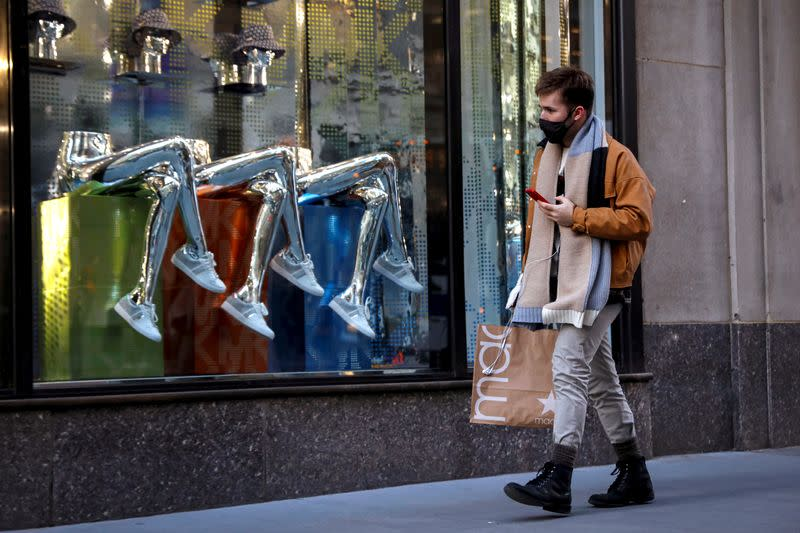 FILE PHOTO: A man shops on 5th Avenue in New York