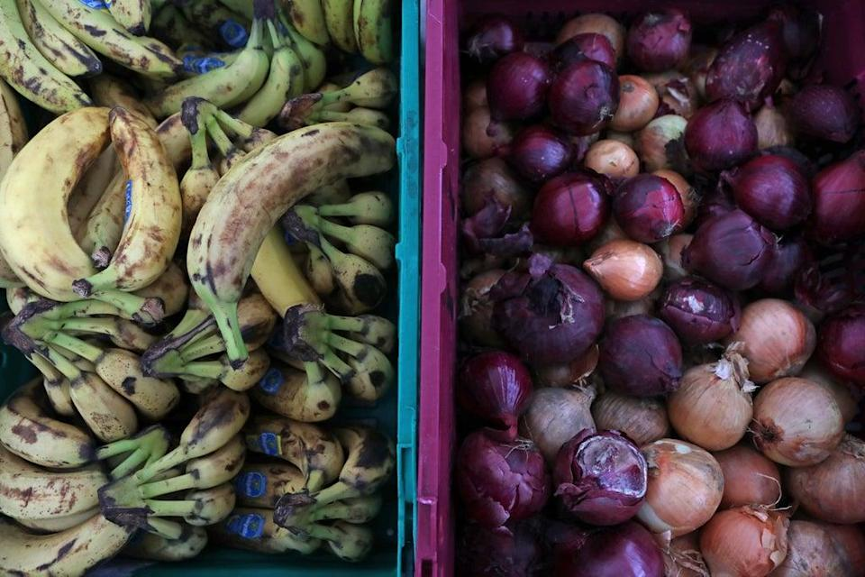 Food laid out in crates at a food bank in north London (Luciana Guerra/PA) (PA Archive)