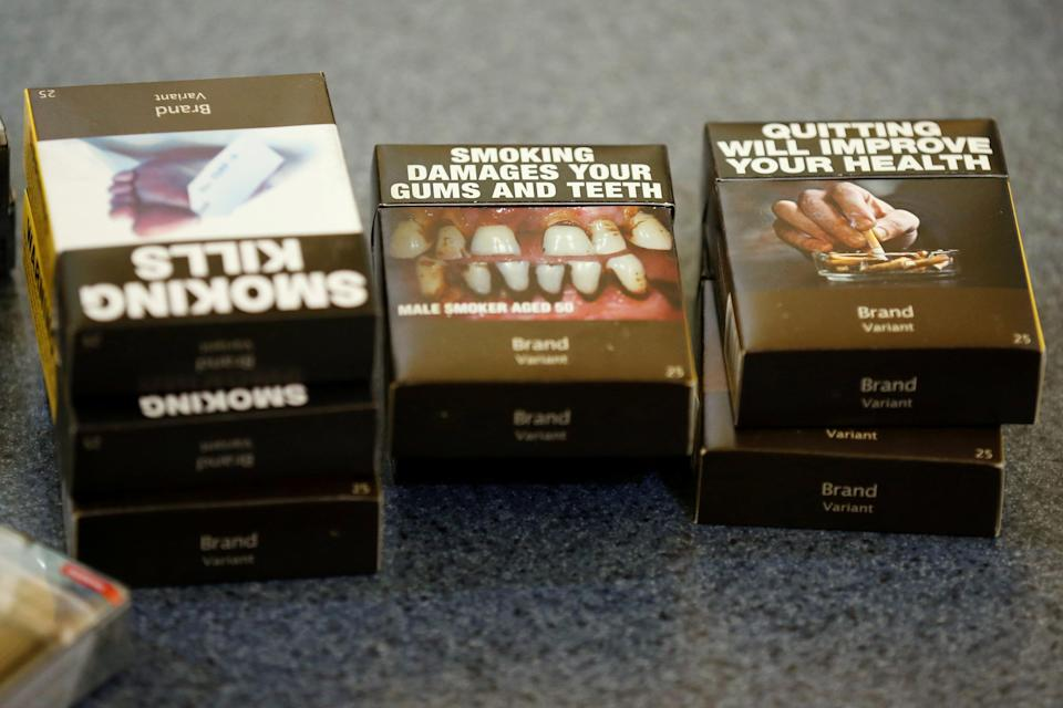 Examples of plain cigarette packaging in Canada. (FILE PHOTO: Reuters/Chris Wattie)