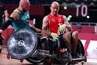 Australia's Chris Bond (left) and Denmark's Sebastian Fredriksen fight for the ball during the Group A wheelchair rugby match between Australia and Denmark
