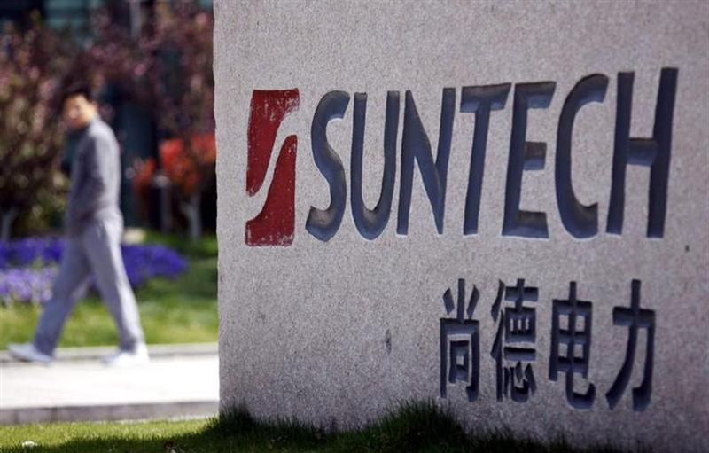 A man walks past Suntech Power Holdings' headquarters in Wuxi, Jiangsu province, in this March 21, 2013 file photo.