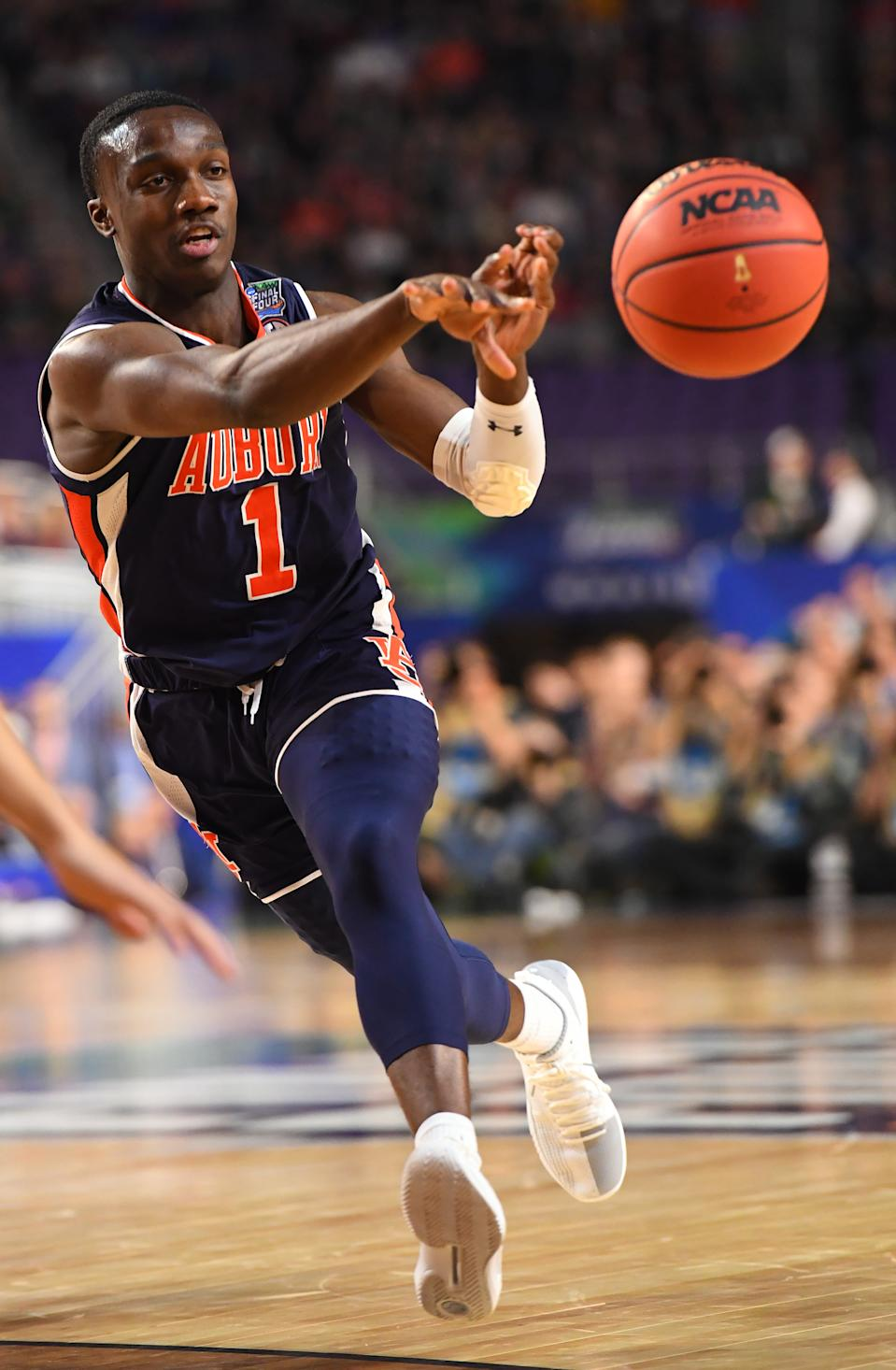 Jared Harper #1 of the Auburn Tigers passes against the Auburn Tigers during the first half of the semifinal game in the NCAA Men's Final Four at U.S. Bank Stadium on April 06, 2019 in Minneapolis, Minnesota. (Photo by Jamie Schwaberow/NCAA Photos via Getty Images)