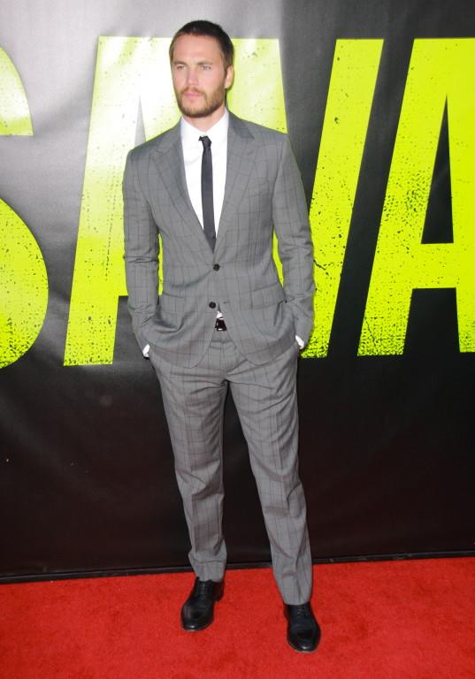Taylor Kitsch attending the 'Savages' premiere at Regency Village Theatre