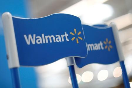 FILE PHOTO: Walmart signs are displayed inside a Walmart store in Mexico City.