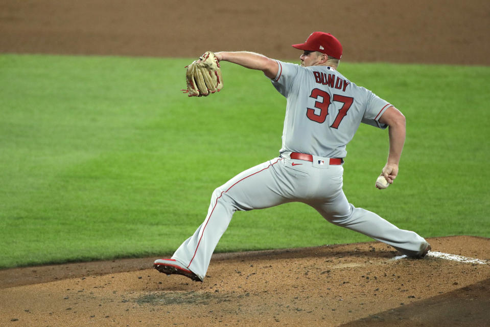 Los Angeles Angels starting pitcher Dylan Bundy throws against the Seattle Mariners during the third inning of a baseball game, Thursday, Aug. 6, 2020, in Seattle. (AP Photo/Ted S. Warren)