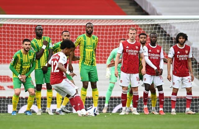 Willian's first Arsenal goal came with a fine last-minute free-kick as the Gunners relegated West Brom.