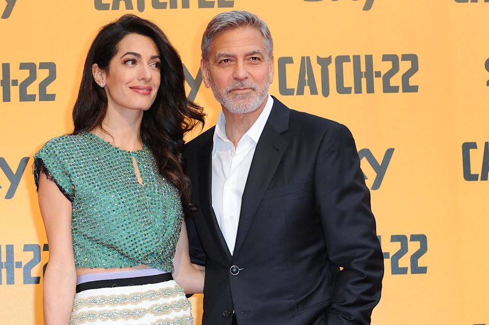 George Clooney, depicted with his wife Amal Clooney, says he steered clear of Hollywood-sounding names for their children. (Photo: Mondadori via Getty Images/Archivio Mondadori via Getty Images/Mondadori via Getty Images)