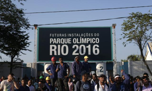 Construction workers on strike stand outside the Rio 2016 Olympic Park construction site in Rio de Janeiro
