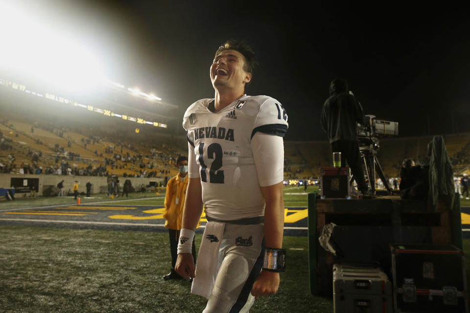 Nevada Wolf Pack quarterback Carson Strong (12) celebrates after a win against the California Golden Bears during an NCAA football game on Saturday, Sept. 4, 2021 in Berkeley, Calif. (AP Photo/Lachlan Cunningham)