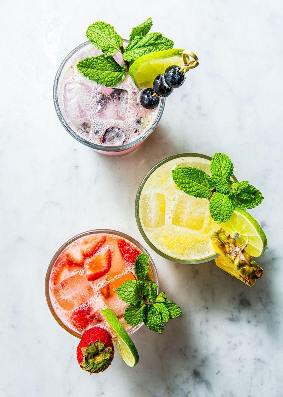 """<p>Turn your night into a pick-your-own-cocktail night with mojitos made with strawberry, blueberry, or pineapple. Whatever you choose, you're right.<br></p><p>Get the recipe from <a href=""""https://www.delish.com/cooking/recipes/a53357/blueberry-pineapple-strawberry-mojito-recipes/"""" rel=""""nofollow noopener"""" target=""""_blank"""" data-ylk=""""slk:Delish"""" class=""""link rapid-noclick-resp"""">Delish</a>.</p>"""