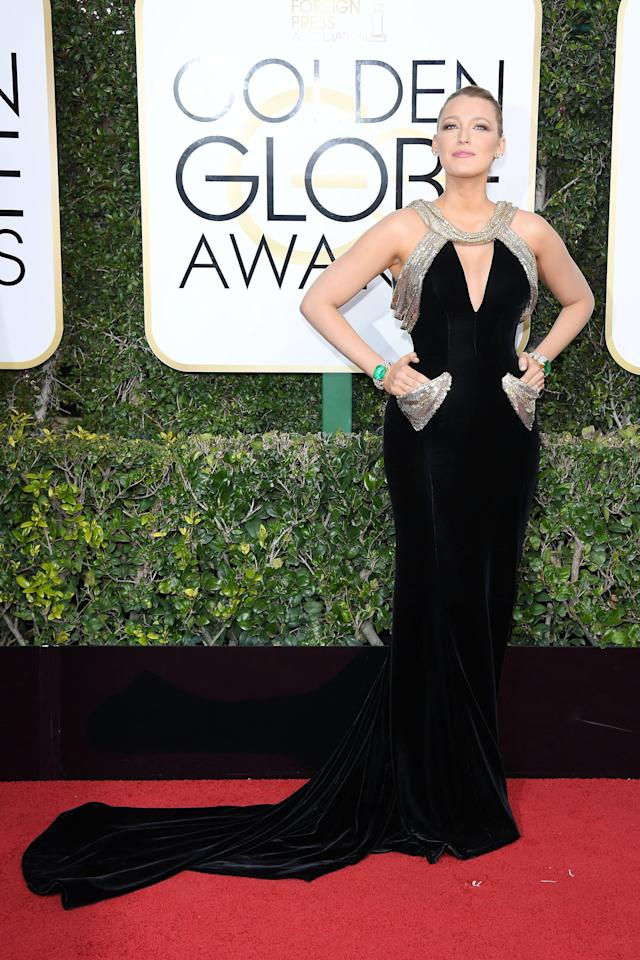 """<p><a rel=""""nofollow"""" title=""""Latest photos and news for Blake Lively"""" href=""""https://www.popsugar.com/Blake-Lively"""">Blake Lively</a> in an <a rel=""""nofollow"""" href=""""https://www.popsugar.com/fashion/Blake-Lively-Versace-Dress-Golden-Globes-2017-42962711"""">Atelier Versace gown with pockets</a> and Lorraine Schwartz jewels in 2017.</p>"""
