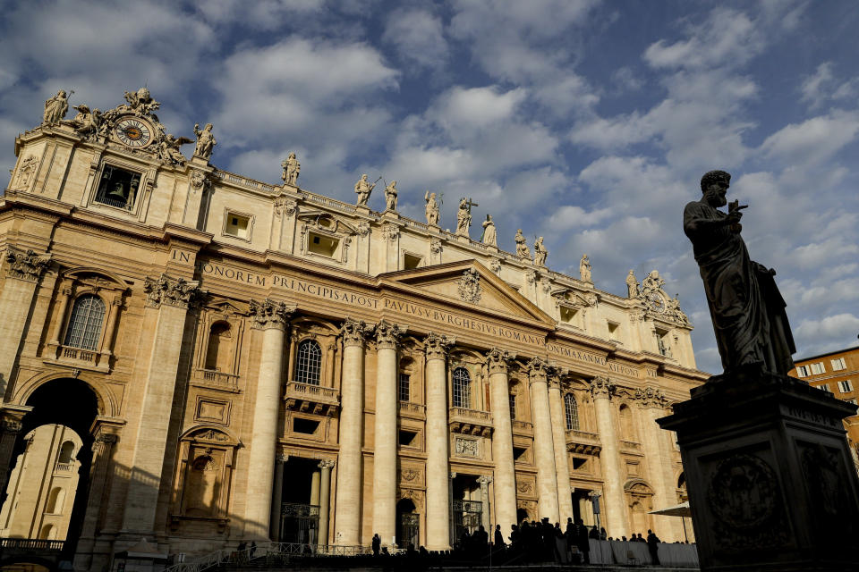 The statue of St. Peter is silhouetted in front of St. Peter's Basilica prior to the arrival of Pope Francis for his weekly general audience, in St. Peter's Square, at the Vatican, Wednesday, Nov. 27, 2019. (AP Photo/Andrew Medichini)