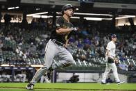 Pittsburgh Pirates' Bryan Reynolds hits a RBI double during the fifth inning of a baseball game against the Milwaukee Brewers Friday, April 16, 2021, in Milwaukee. (AP Photo/Morry Gash)
