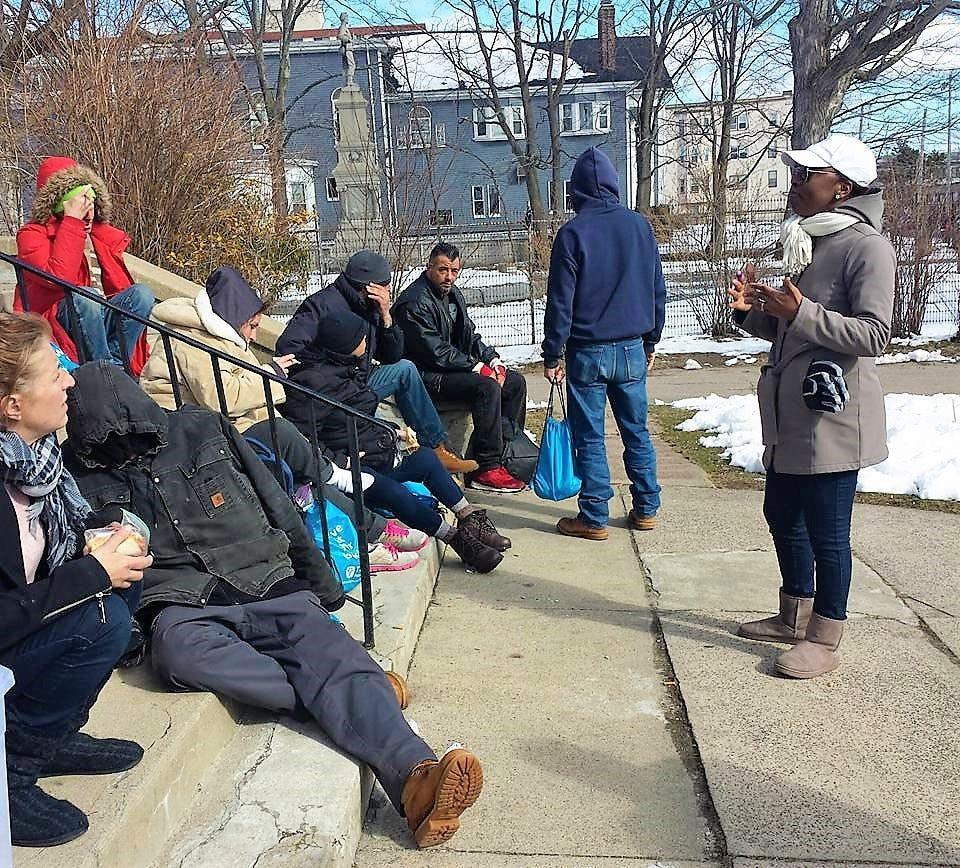 Lovern Gordon, left, speaks to a group of homeless people near Boston. Gordon, a survivor of domestic abuse and founder of the Love Life Now Foundation, said that reaching out to others is the best way to overcome trauma. She is skeptical, however, that communities of color will have the resources needed in the wake of COVID-19's devastating effect on their communities.