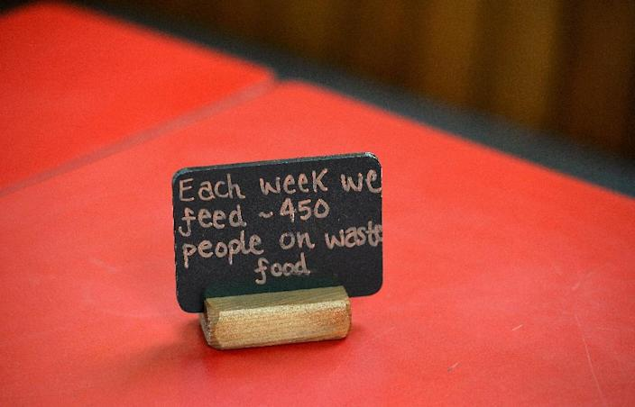 A sign on a table at a Real Junk Food Project (RJFP) cafe in Brighton, southeast England, on September 11, 2015 (AFP Photo/Glyn Kirk)