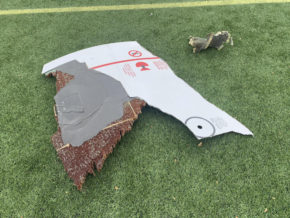 In this photo provided by the Broomfield Police Department on Twitter, debris is scattered across turf field at Commons Park, Saturday, Feb. 20, 2021, in Broomfield, Colo. The police ask that the area be avoided if possible. A commercial airliner dropped debris in Colorado neighborhoods during an emergency landing Saturday. The Broomfield Police Department said on Twitter that the plane landed safely at Denver International Airport and that no injuries had been reported from the incident. (Broomfield Police Department via AP)