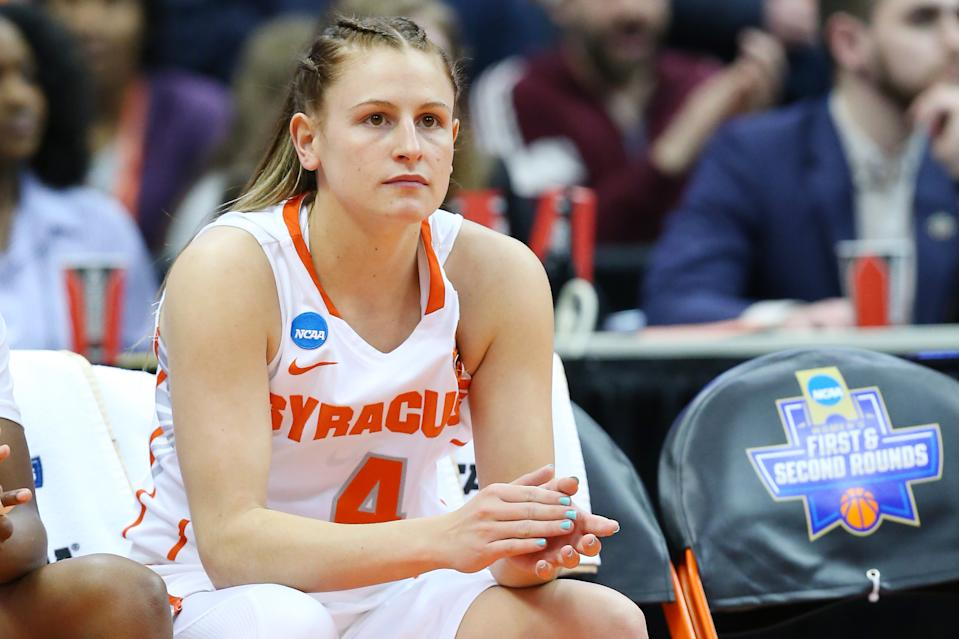 SYRACUSE, NY - MARCH 25: Tiana Mangakahia #4 of the Syracuse Orange sits on the bench prior to the game against the South Dakota State Jackrabbits in the second round of the 2019 NCAA Women's Basketball Tournament at the Carrier Dome on March 25, 2019 in Syracuse, New York. (Photo by Rich Barnes/Getty Images)