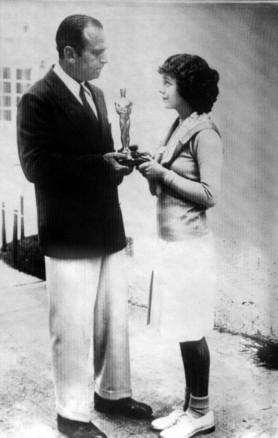<p>Janet picked up the award for Best Actress at the <em>very</em> first Oscars in '29, which is a v cool fact to have about yourself. She did so in a simple but classic outfit featuring a blazer, skirt, tights, and loafers which deserves a whole other award on its own, TBH.</p>