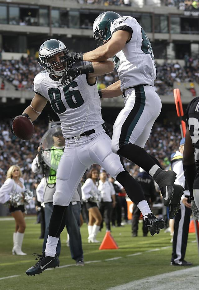 Philadelphia Eagles tight end Zach Ertz (86) celebrates with tight end James Casey after Ertz caught a 15-yard touchdown during the second quarter of an NFL football game against the Oakland Raiders in Oakland, Calif., Sunday, Nov. 3, 2013. (AP Photo/Marcio Jose Sanchez)