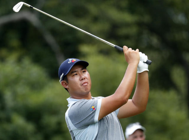 Byeong Hun An hits his tee shot on the third hole during the final round of the Wyndham Championship golf tournament at Sedgefield Country Club in Greensboro, N.C., Sunday, Aug. 4, 2019. (AP Photo/Chris Seward)