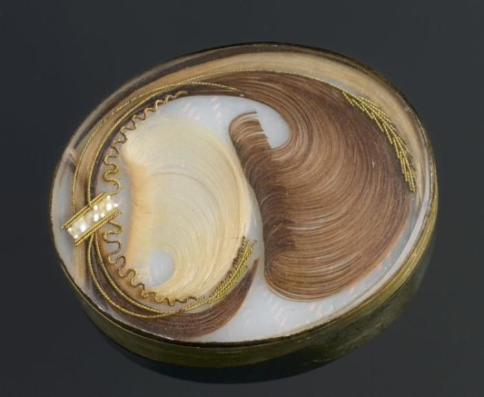 """<span class=""""caption"""">Brooch containing human hair. Mourning jewellery containing hair was popular among the Victorians.</span> <span class=""""attribution""""><a class=""""link rapid-noclick-resp"""" href=""""https://commons.wikimedia.org/wiki/File:Brooch_containing_human_hair,_Europe,_1701-1900_Wellcome_L0058632.jpg"""" rel=""""nofollow noopener"""" target=""""_blank"""" data-ylk=""""slk:Wellcome Images"""">Wellcome Images</a>, <a class=""""link rapid-noclick-resp"""" href=""""http://creativecommons.org/licenses/by/4.0/"""" rel=""""nofollow noopener"""" target=""""_blank"""" data-ylk=""""slk:CC BY"""">CC BY</a></span>"""