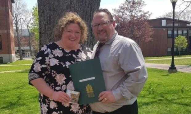 Arsenault, right, with his wife Angela Larter, graduated from UPEI this week, 26 years after he started as a student at the university.