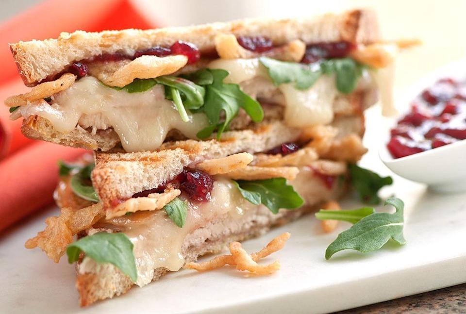"""<p>It's important to know <a href=""""https://www.thedailymeal.com/holidays/how-long-thanksgiving-leftovers-are-safe-to-eat?referrer=yahoo&category=beauty_food&include_utm=1&utm_medium=referral&utm_source=yahoo&utm_campaign=feed"""" rel=""""nofollow noopener"""" target=""""_blank"""" data-ylk=""""slk:how long your Thanksgiving leftovers last"""" class=""""link rapid-noclick-resp"""">how long your Thanksgiving leftovers last</a>. If you want to use it all up before it spoils, consider piling up all your extra food onto slices of crusty white or sourdough bread and baking until good and gooey.</p> <p><a href=""""https://www.thedailymeal.com/best-recipes/day-after-thanksgiving-paninis?referrer=yahoo&category=beauty_food&include_utm=1&utm_medium=referral&utm_source=yahoo&utm_campaign=feed"""" rel=""""nofollow noopener"""" target=""""_blank"""" data-ylk=""""slk:For the Day After Thanksgiving Paninis recipe, click here."""" class=""""link rapid-noclick-resp"""">For the Day After Thanksgiving Paninis recipe, click here.</a></p>"""