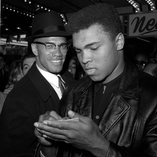 <p>World Heavyweight Boxing Champion, Muhammad Ali, right, is shown with Black Muslim Leader, Malcolm X, outside the Trans-Lux Newsreel Theater on Broadway at 49th Street, New York City, March 1, 1964. They had just watched a screening of films on Ali's title fight with Sonny Liston in Miami Beach, Feb. 25. (AP Photo)</p>
