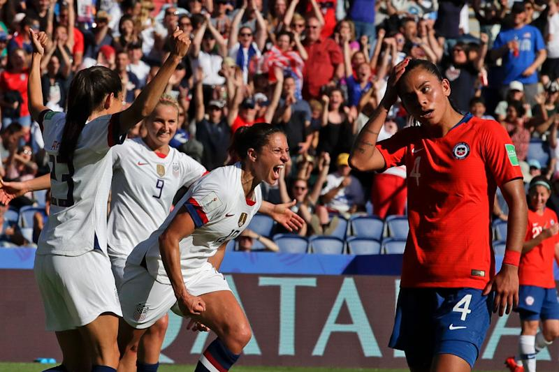United States' Carli Lloyd, center, celebrates with teammates after scoring their side's third goal during the Women's World Cup match between United States and Chile.
