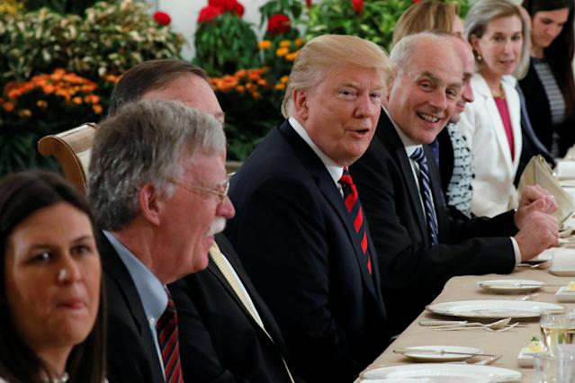 <p>U.S. President Donald Trump and members of his delegation, including National Security Advisor John Bolton and White House Chief of Staff John Kelly, attend lunch during a meeting at the Istana in Singapore June 11, 2018. (PHOTO: Reuters) </p>