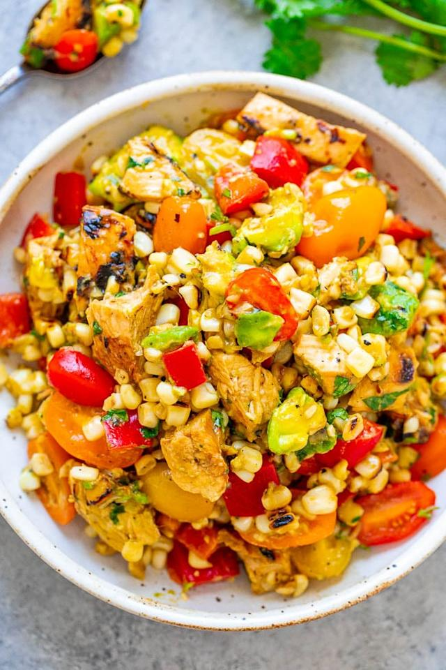 "<p>This isn't your <a href=""http://www.averiecooks.com/grilled-chicken-and-corn-salad/"" target=""_blank"" class=""ga-track"" data-ga-category=""Related"" data-ga-label=""http://www.averiecooks.com/grilled-chicken-and-corn-salad/"" data-ga-action=""In-Line Links"">typical chicken salad</a>. Instead of topping off some greens, you'll combine chicken, corn, avocados, red bell peppers, and tomatoes, then dress the mixture with lime juice, cilantro, salt, and pepper (plus olive oil, if you like).</p> <p><strong>Get the recipe:</strong> <a href=""http://www.averiecooks.com/grilled-chicken-and-corn-salad/"" target=""_blank"" class=""ga-track"" data-ga-category=""Related"" data-ga-label=""http://www.averiecooks.com/grilled-chicken-and-corn-salad/"" data-ga-action=""In-Line Links"">grilled chicken and corn salad</a></p>"