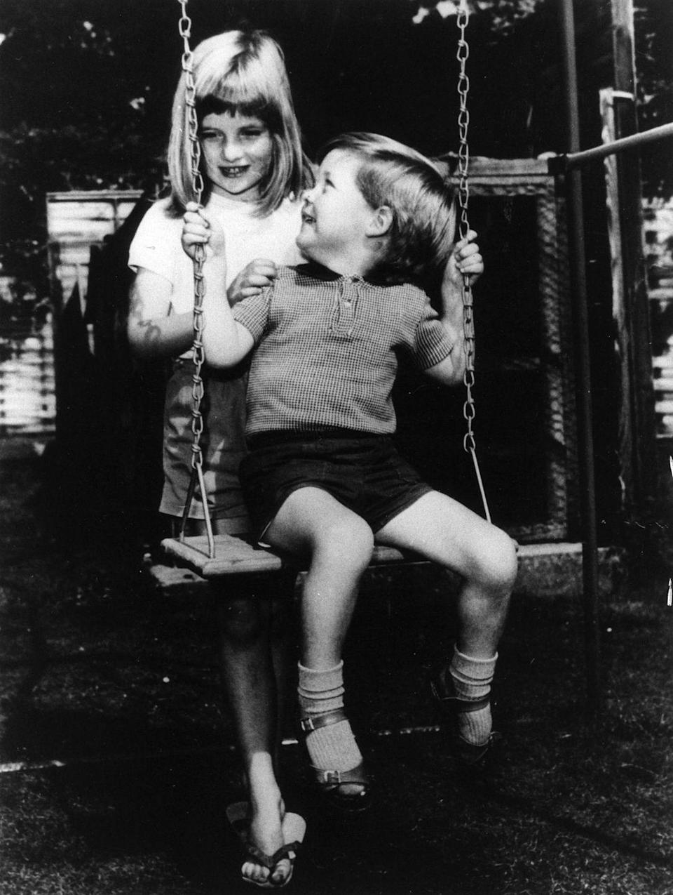 <p>Diana playing with her brother Charles Edward Maurice on the grounds of Park House, Sandringham when she was six years old.</p>