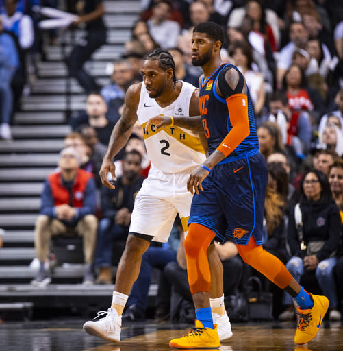 TORONTO, CANADA - MARCH 22: Kawhi Leonard #2 of the Toronto Raptors and Paul George #13 of the Oklahoma City Thunder defend their positions during the game on March 22, 2019 at Scotiabank Arena in Toronto, Ontario, Canada. (Photo by Zach Beeker/NBAE via Getty Images)