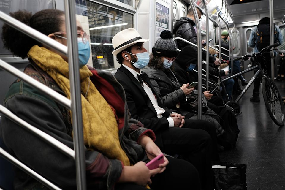 People ride on a subway train at a Brooklyn station on November 18, 2020 in New York City. (Spencer Platt/Getty Images)