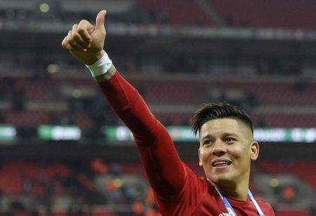 Manchester United's Marcos Rojo celebrates winning the EFL Cup Final
