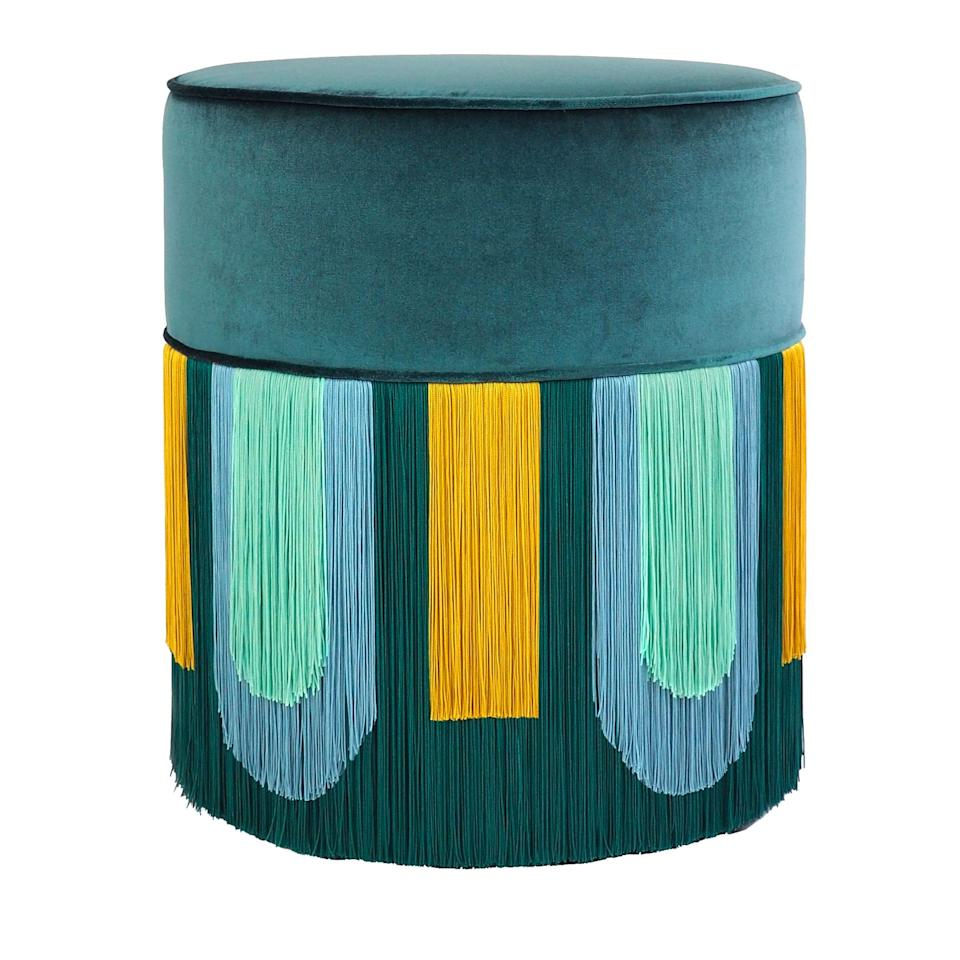 """<p>This exquisite ottoman by artisan Lorenza Bozzoli Design, is the epitome of retro chic. A cylindrical silhouette and a cascade of multi-colored fringe accents add dynamic drama to a modern design. <br><br>Amy's A-List Anecdote: <em>""""I absolutely adore the Roaring Twenties, and this unique stool with its flapper-esque fringe and rich peacock jewel tone transports me directly there."""" </em></p><p><a href=""""https://artemest.com/"""">Click to View More</a><br></p><p><em><br></em></p>"""