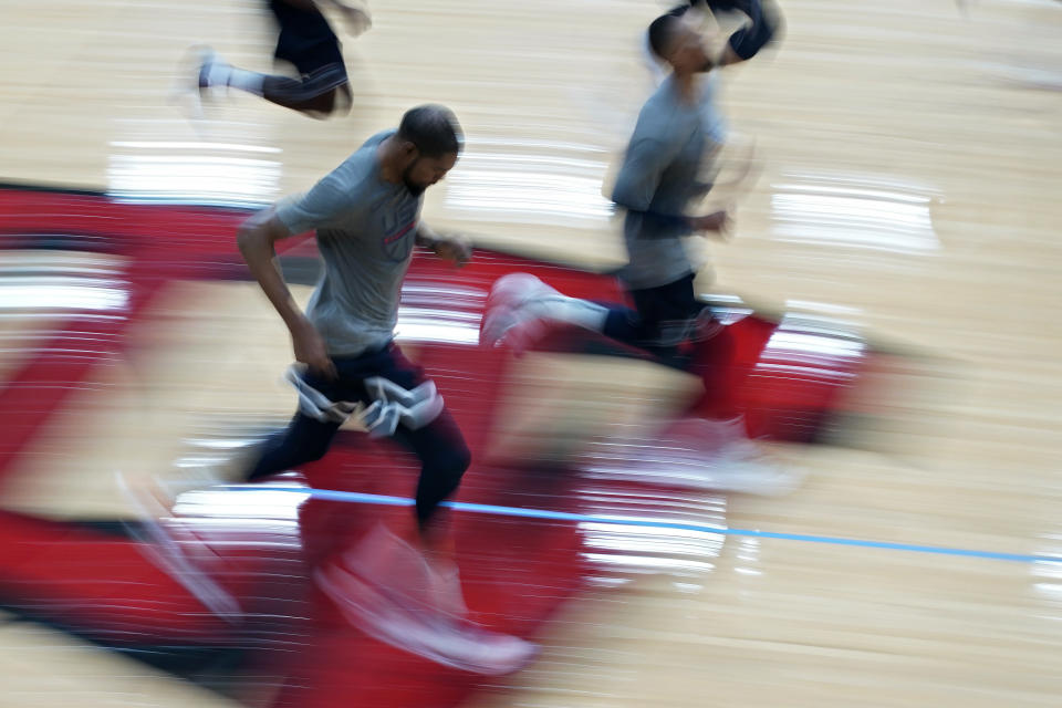 Kevin Durant runs during during practice for USA Basketball, Wednesday, July 7, 2021, in Las Vegas. (AP Photo/John Locher)