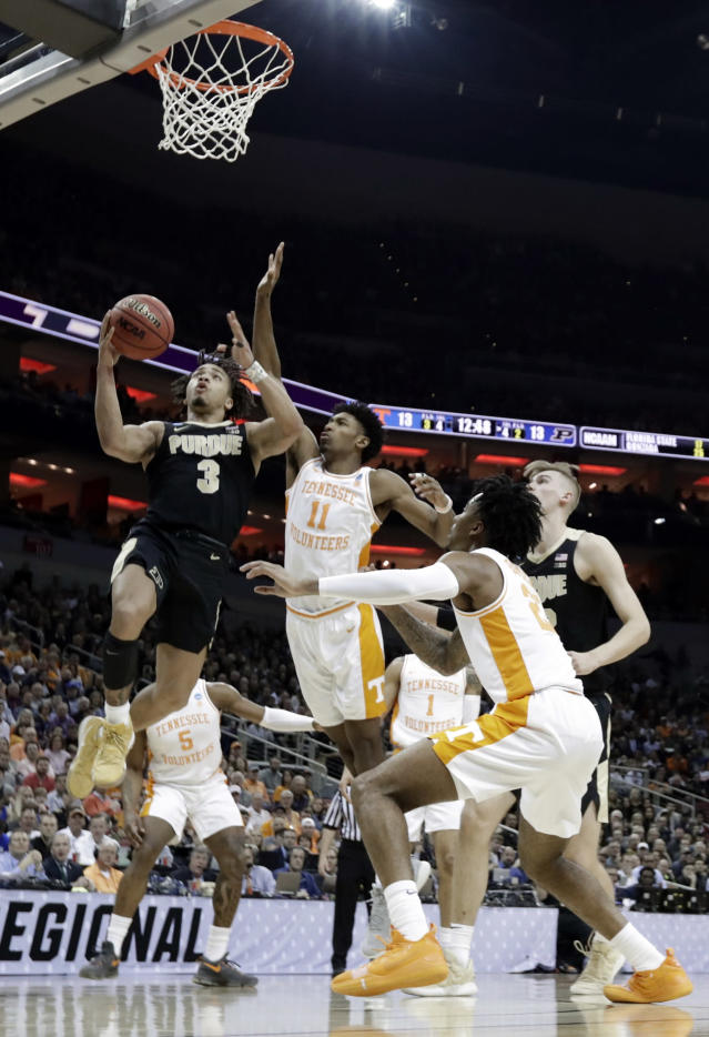 <p>Purdue's Carsen Edwards (3) drives ahead of Tennessee's Kyle Alexander (11) during the first half of a men's NCAA Tournament college basketball South Regional semifinal game, Thursday, March 28, 2019, in Louisville, Ky. (AP Photo/Michael Conroy) </p>