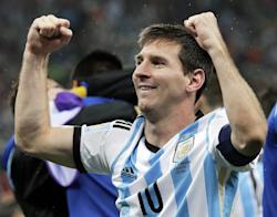 Lionel Messi pumps his fists after Argentina's shootout win over the Netherlands. (AP)