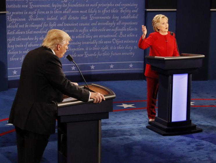 Donald Trump and Democratic presidential nominee Hillary Clinton speak at the same time during the presidential debate at Hofstra University. (Rick T. Wilking/Pool via AP)