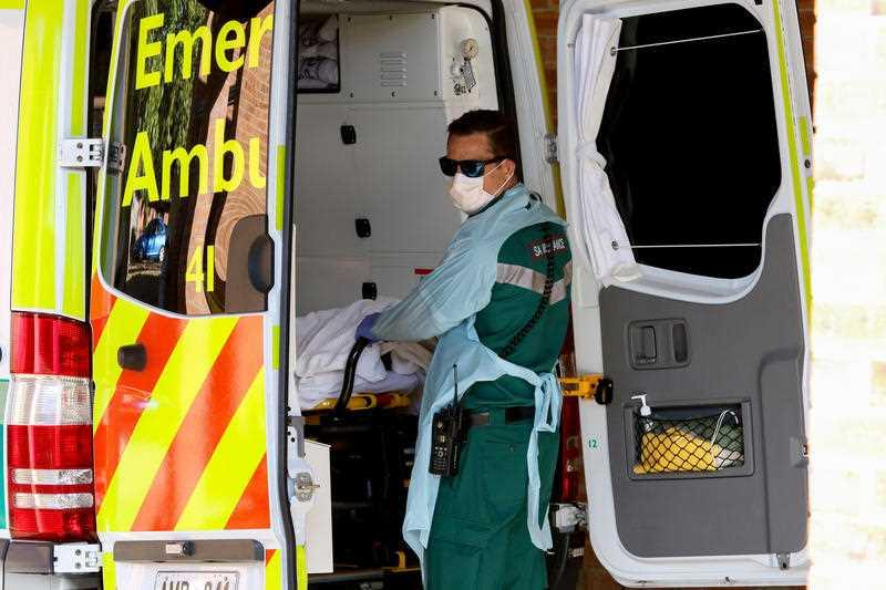 A paramedic wears protective clothing while outside the Mount Barker Hospital in Adelaide