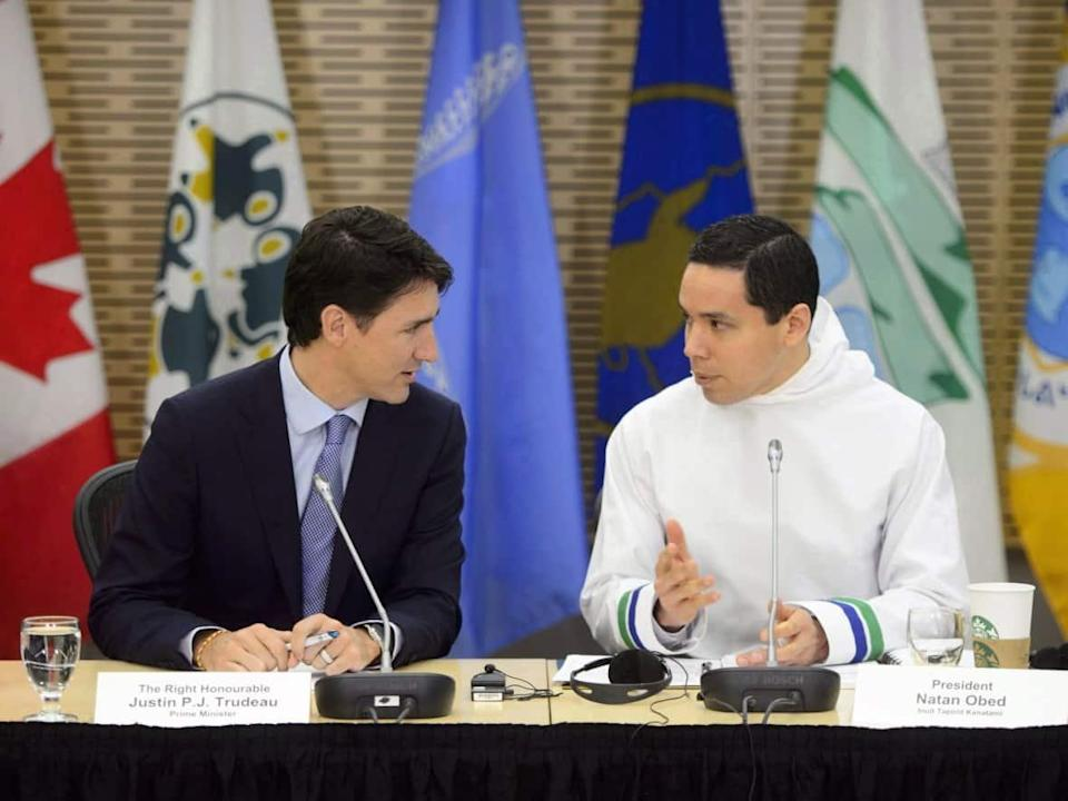 Prime Minister Justin Trudeau, left, and Natan Obed, president of Inuit Tapiriit Kanatami, speak in March. Obed sent Trudeau a letter this month outlining ITK's stance on the NunatuKavut community council. (Sean Kilpatrick/The Canadian Press - image credit)