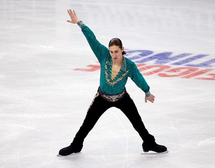 Jason Brown competes in the men's free skate at the U.S. Figure Skating Championships in Boston, Sunday, Jan. 12, 2014. (AP Photo/Elise Amendola)